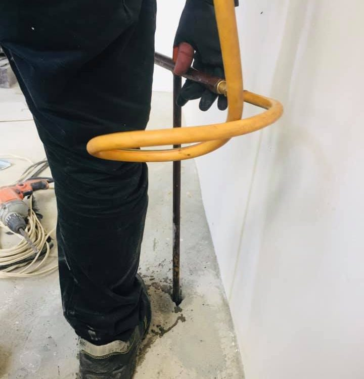 Cordoning the floor slab perimeter with a termiticide to control and prevent ter...