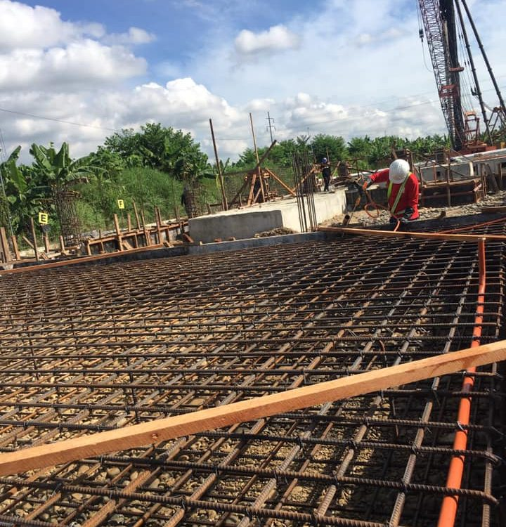 Soil Poisoning before pouring on Gridline tie beam footings and pedestals. This ...